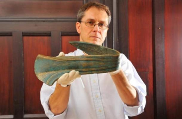 Dr Tim Pestell with the Bronze Age dirk, which was ceremonially bent when it was made. The precious artifact had been used as a door stop.