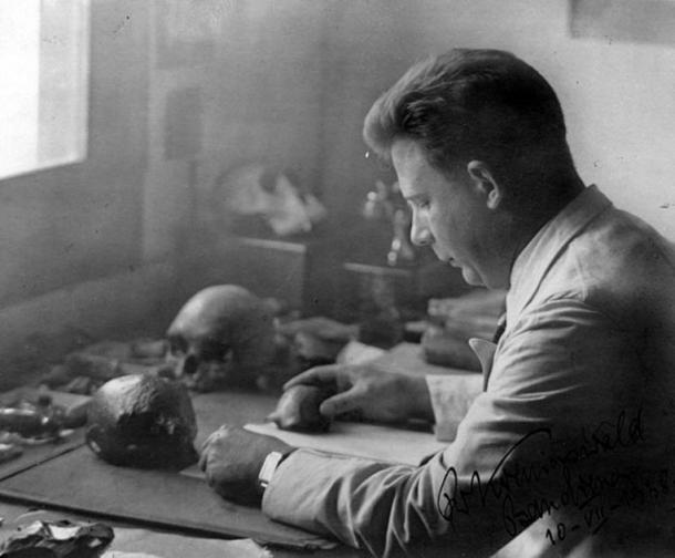 Dr. G.H.R. von Koenigswald studying fossils from Java c. 1938.