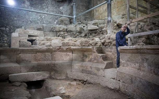 Dr. Joe Uziel, Excavation Director, standing on steps of the amphitheater (Image: Israel Antiquities)