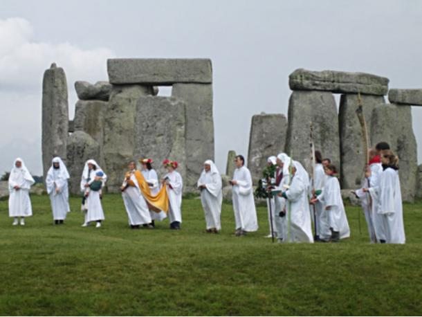 Druids celebrating rituals at Stonehenge.