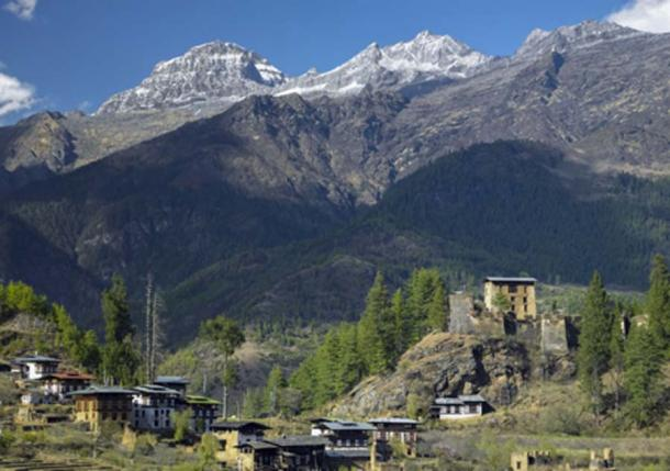 Drukgyel Dzong and the Himalayas - Kingdom of Bhutan. (mrallen/ Adobe Stock)