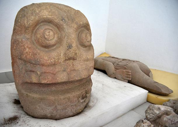 Each of the stone heads is approximately 70 cm high and weighs around 200 kilograms. (Image: Héctor Montaño, AnchorINAH)