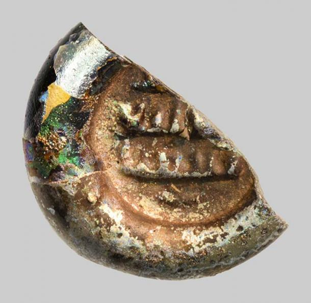 Early-Islamic glass weight of just 12 millimeters in diameter with an Arabic inscription found at Khirbat al-Minya.