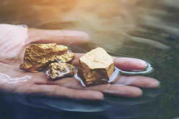 Early humans, and perhaps even our hominid ancestors, would have found gold nuggets in streams dispersed across the globe. (lesterman /Adobe Stock)
