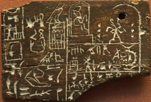 Ebony label EA                  32650 from Den's tomb. The upper right register depicts                  king Den twice: at the left he is sitting in his Heb Sed                  pavilion, at the right he is running a symbolic race                  around D-shaped markings. 1st Dynasty. (Photo:                  CaptMondo) British Museum. (CC BY-SA 3.0)