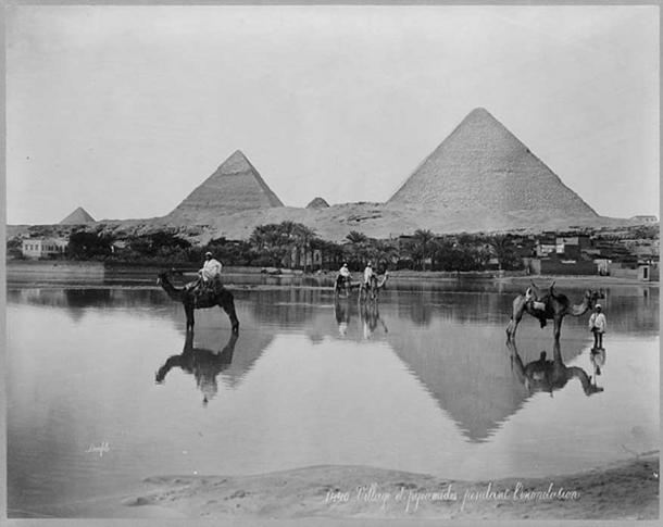 Egypt. Village and pyramids during the flood-time. ca. 1890