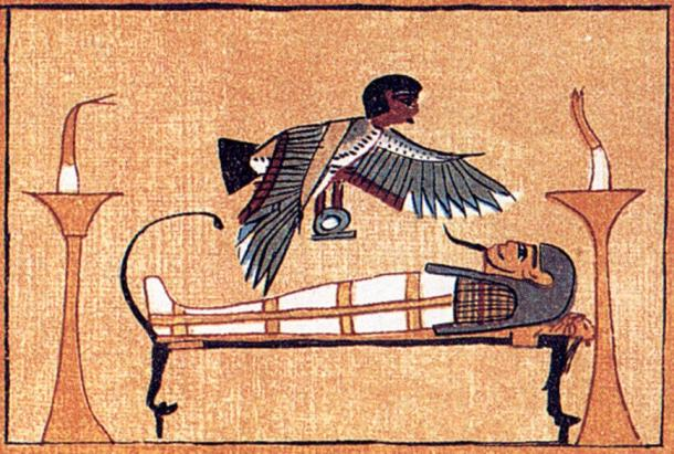 The Egyptian ba, or the personality part of the soul, hovers over its mummy as it lies on a bier.