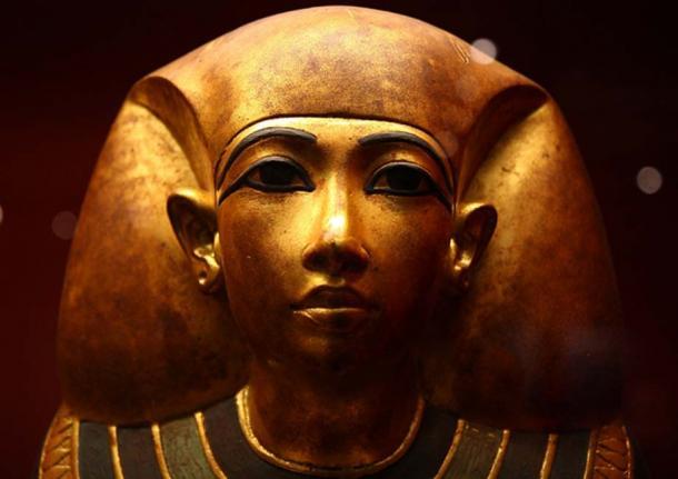 Shining golden Egyptian funeral mask.