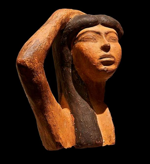 A rare sample of Egyptian terra cotta sculpture depicts Isis mourning Osiris. The sculpture portrays a woman raising her right arm over her head, a typical gesture of mourning.
