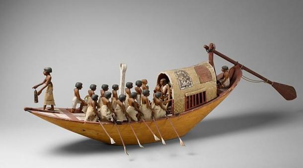 Egyptian traveling boat being rowed.