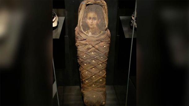 The Egyptian boy's mummy coffin and mummy portrait. (Nerlich AG, et al. PLOS One (2020) / CC BY 4.0)