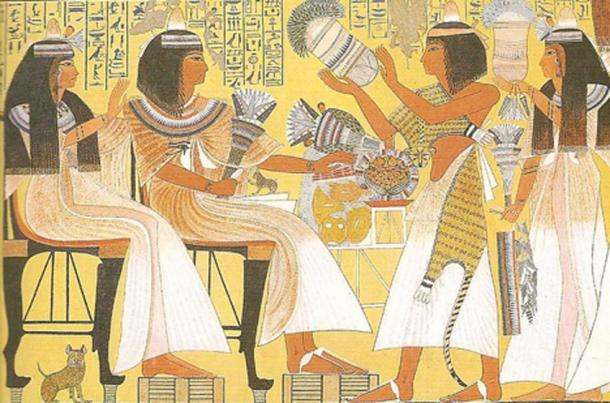 Egyptians wearing perfume cone. The cones would melt and cause fragrance to soak their wigs. painting from Tomb at Thebes dates to about 1275 BC. (CC BY 2.0)