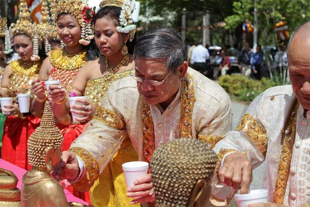 Elder members of the community perform a ritual for the Cambodian New Year. (Sam Sith / CC BY-SA 2.0)