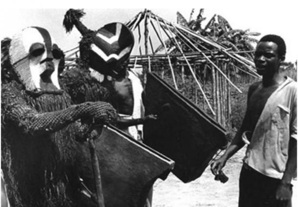 Elders in ritual masks; village kikomo, kiloshi chiefdom, Eastern Songye