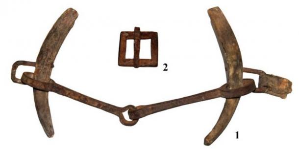 Elements of horse equipment, along with the saddle, were recovered from the burial site. A bit with horn cheekpieces and a buckle. (Nikolai Seregin / CC BY-SA 4.0)