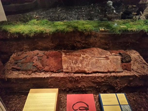 The Elling Woman on display at the Silkeborg Museum, along with the skin rope found with her body.