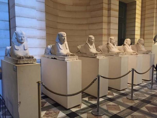 Entrance sphinxes. Six small, beautifully carved sphinxes greet you as you enter the Egyptian portion of the Louvre. Each has the face of an individual from Asia. (Photo by the author).