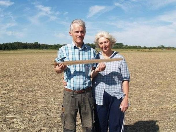 Ernst Christiansen and Lis Therkelsen with the 3,000-year-old sword they discovered. (Courtesy of Museum Vestsjælland)
