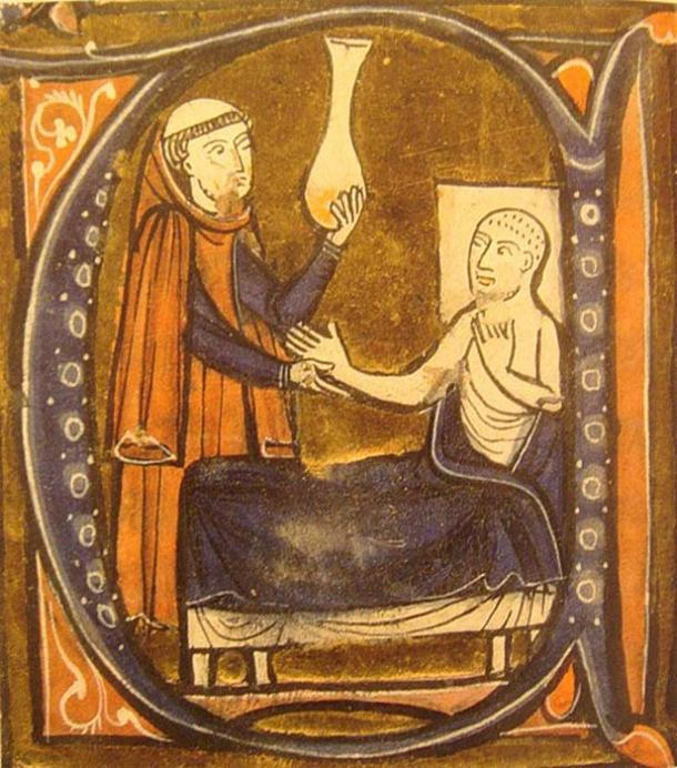 """European depiction of the Persian (Iranian) doctor Al-Razi, in Gerardus Cremonensis """"Recueil des traités de médecine"""" 1250-1260. A surgeon (left) holds the matula, a vessel for collecting the urine. (Public Domain)"""