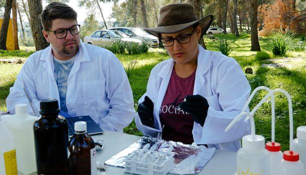 Evidence-based findings: Dr Sophia Aharonovich carries out a soil sample test at the Ziklag field site alongside student Edward Clancy. (Macquarie University)