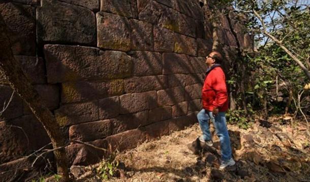 Examining the immense wall.