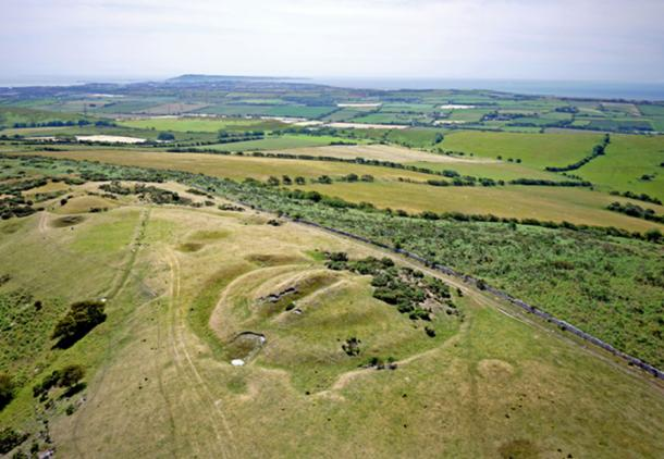 Example of a barrow, showing a circular ditch around a mound. Bronkham Hill, Dorset (Alan Denney / flickr)
