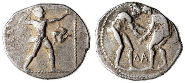 Example of a silver stater coin from Aspendos dating to 370-333 BC. Obverse: Olympic games-type scene: two wrestlers grappling, the letters delta and alpha between their legs; Reverse: Olympic games-type scene of a slinger, wearing short chiton, discharging sling to right, triskeles on right with feet clockwise.