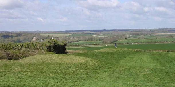 Example of a cursus monument. The earthworks of the Dorset Cursus' southwestern terminal from the nearby long barrow. The enlarged bank ends can be clearly seen, and the end of the cursus is squared off with a terminal bank. (Jim Champion/ CC BY-SA 2.5)