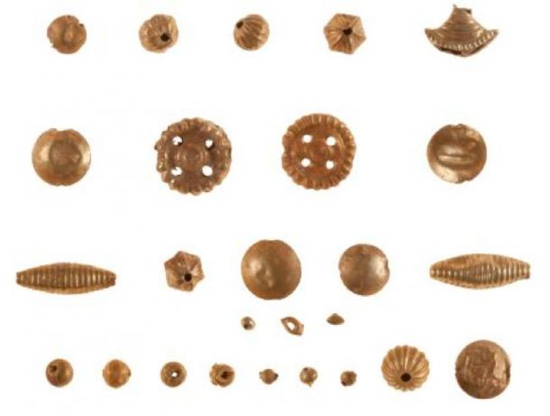 Examples of the Minoan treasure and in particular, gold beads unearthed at the excavation site. (Greece Ministry of Culture and Sports)