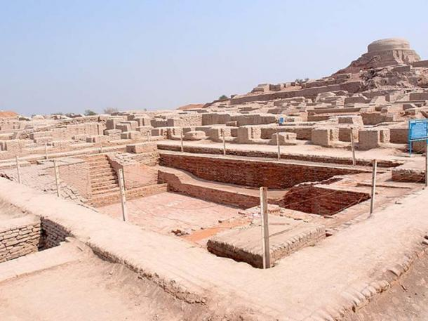 Excavated ruins of Mohenjo-daro, with the Great Bath in the foreground and the Buddhist Stupa in the background. (CC BY-SA 3.0)