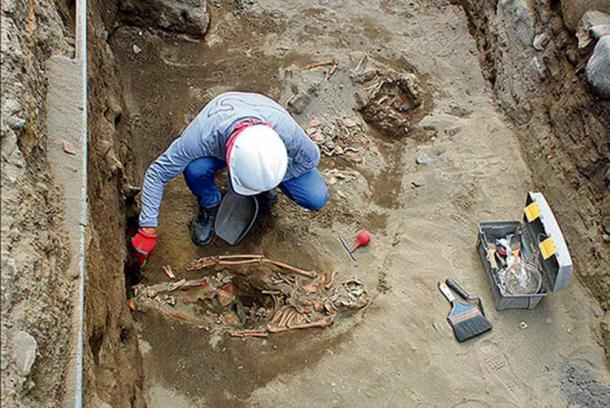 Excavating the remains of one of the sacrificed children.