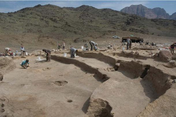 Excavation of Structure O75 looking towards the south-east showing the two-tier benches and moulded postholes. (Image: Researchgate)