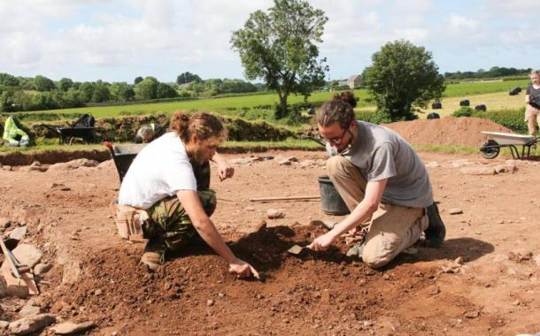 Excavations underway at the burial mound next to Bryn Celli Ddu, researchers Danny Lee and Cameron Black