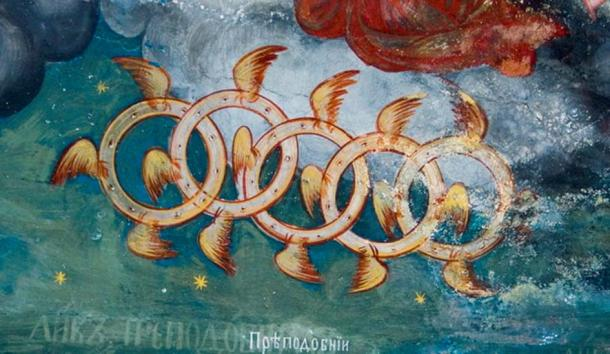 """Ezekiel's Wheel in St. John the Baptist Church in Kratovo, Macedonia. Fresco from the 19th century. These are known as """"Ofanim, Wheels of Galgallin."""" It is said that they were the actual wheels of the 'Lord's Heavenly Chariot', Merkabah."""