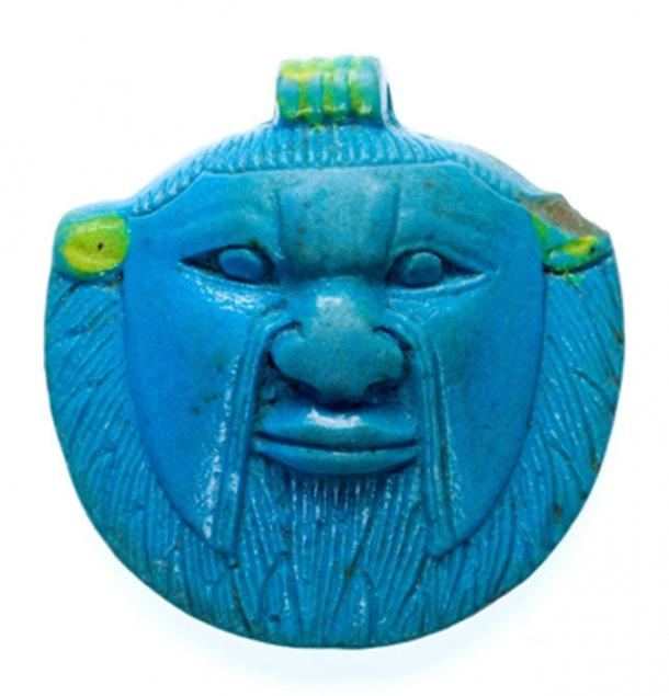 Faience amulet of the head of Bes from the Late Period, 26th to 30th Dynasties. Bes was worshipped and invoked by ordinary Egyptians as a protector. His usual depiction, as a grotesque dwarf with a lion's ears and mane, was thought to deter the approach of the malevolent forces believed to cause illness. Metropolitan Museum of Art, New York.
