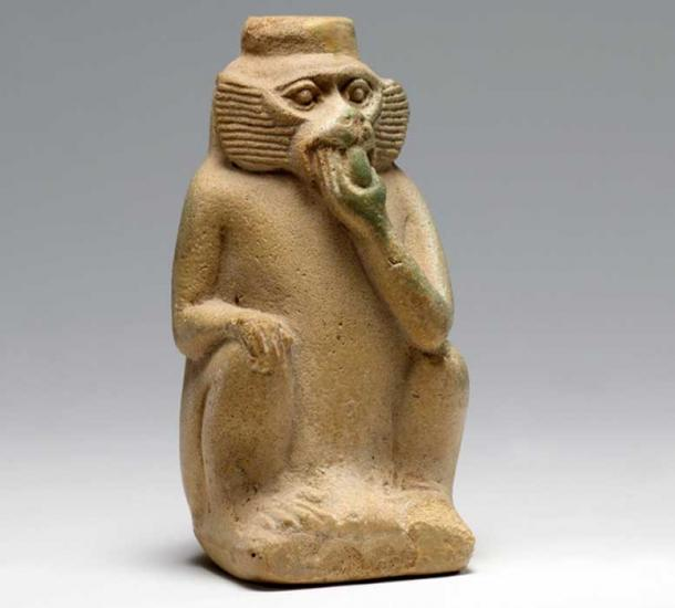 Faience perfume vessel in the shape of a monkey eating fruit. 18th Dynasty. Metropolitan Museum of Art, New York.