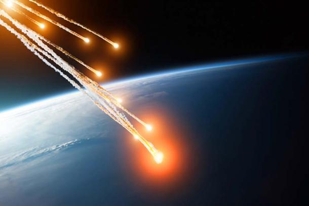 Falling burning flares of several meteorites of asteroids in the Earth's atmosphere. Elements of this image furnished by NASA. (aapsky / Adobe)