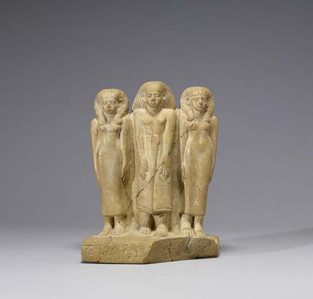 Family Group of Three. Middle Kingdom limestone. (c. 1850-1800 BC)
