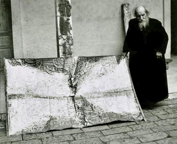 Father Crespi with a metallic artifact at the church of Maria Auxiliadora