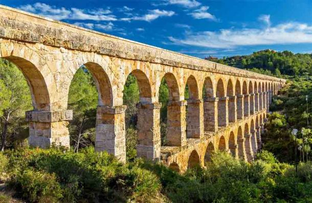 The Les Ferreres Aqueduct, also known as Pont del Diable in Tarragona, Spain was certainly built with limestone from the El Medol Roman quarry. (Leonid Andronov / Adobe Stock)