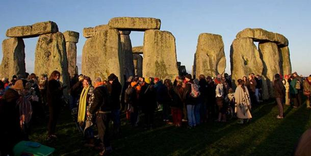 Festive people at Stonehenge, England for the Pagan Winter Solstice Celebration