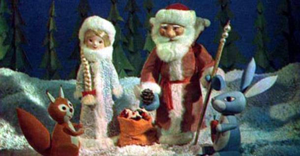 Figures of Father Frost and Snow Maiden providing gifts to their animal friends in an animated holiday show.