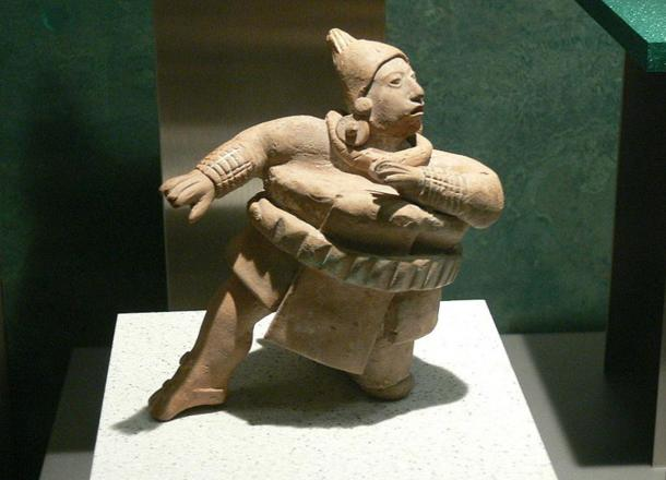 Figurine of a ball player wearing thick padded clothing