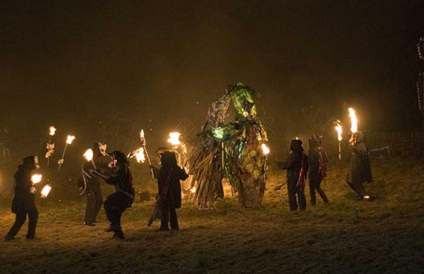 Fire-bearers circle figures of The Green Man fighting Jack Frost