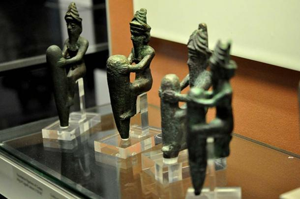 Four copper-alloy statuettes dating to c. 2130 BC, depicting four ancient Mesopotamian gods, wearing characteristic horned crowns.