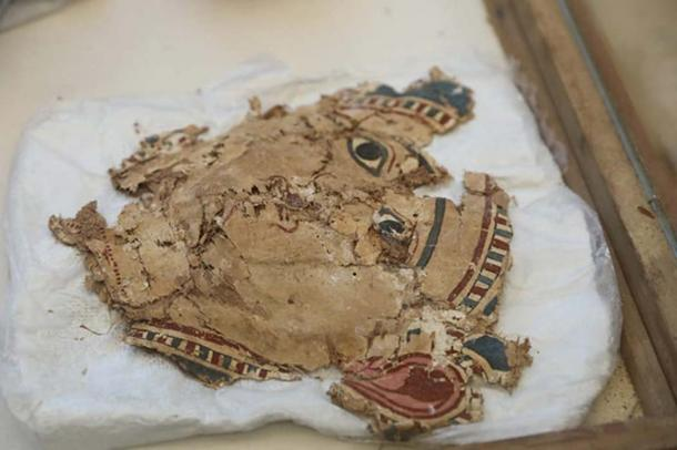 Fragments of colored cartonnage found with the mummy wrappings