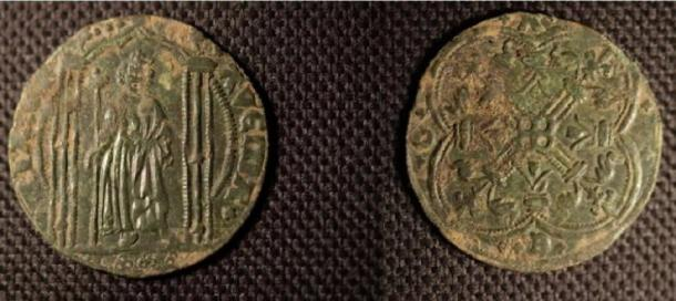 French jetson, an accounting coin, was found hidden in the fireplace of the medieval building. (Llandaff 50+)