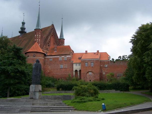 Frombork Cathedral mount and fortifications. In foreground: statue of Copernicus