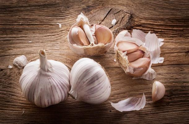 Garlic bulbs and cloves on a wooden table