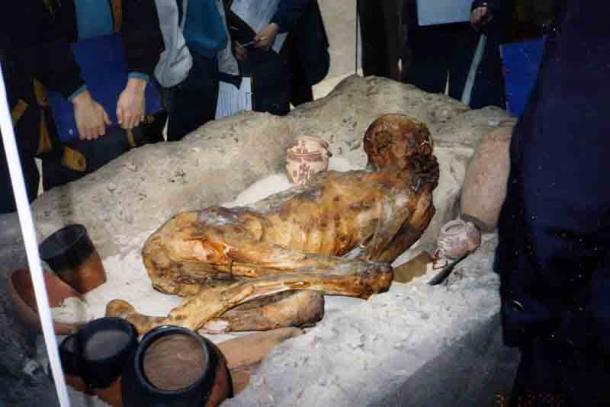 The Gebelein predynastic mummies were preserved through a natural mummification process thanks to the conditions in the desert. They provide a window into understanding the development of the mummification through time. The image shows the reconstructed sand grave of one of the males at the British Museum. (InSapphoWeTrust / CC BY-SA 2.0)